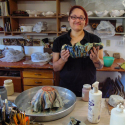 Kendra Arnold glazing two bowls
