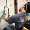 Jason Burley airbrushing Sea Hawk
