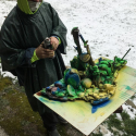 Dylan Aposhyan spray painting the Driftwood Collage Sculpture